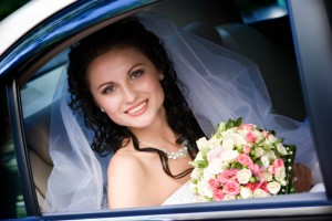 smiling bride sitting in the car